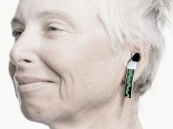 Woman wearing a futuristic-looking hearing aid
