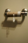toilet paper holder with cardboard inner tube on it