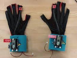 SignAloud Gloves - black gloves with micro processors on the wrists