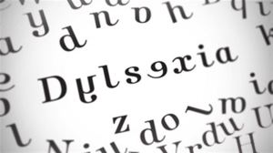 "Letters on a page, some letters are arranged to spell ""dyslexia"", but it is not spelled correctly."