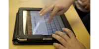 Person's hands on an iPad