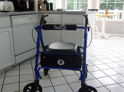 blue walker in a kitchen with a seat and larger wheels