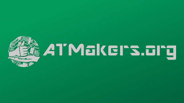 The ATMakers Logo, a forest green rectangle with ATMakers.org imprinted, and a circle with two hands, one palm up and the other a fist with the thumb pointing up. In the background of the circle are tools and circuit boards.