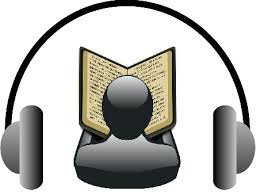 A figure reading a book from behind. Headphones surround the figure