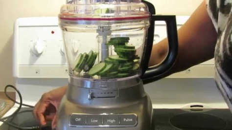 Food processor containing cucumber slices