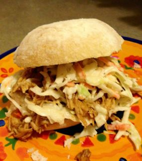 Shredded BBQ chicken sandwich, topped with coleslaw
