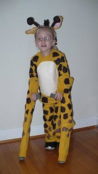 Girl in a giraffe costume. Her crutches make up the front long legs