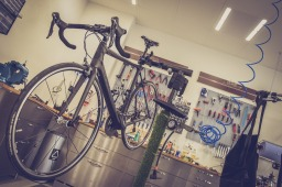 road bike hanging in repair shop