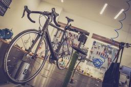 road bike hanging in repair shop